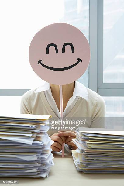 An office worker puts on a happy face.
