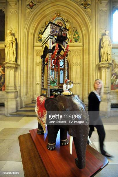 An office worker walks past a 1/3 scale model of the Elephant Clock which was invented by Muslim engineer AlJazari more than 800 years ago at the...