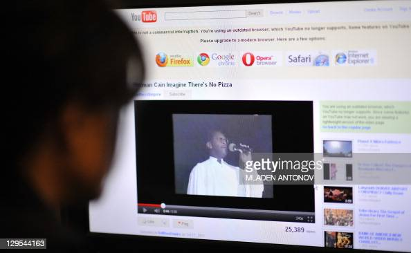 An office worker watches a video made in 1991 and posted on YouTube featuring the US Republican Party Presidential hopefull Herman Cain performing a...