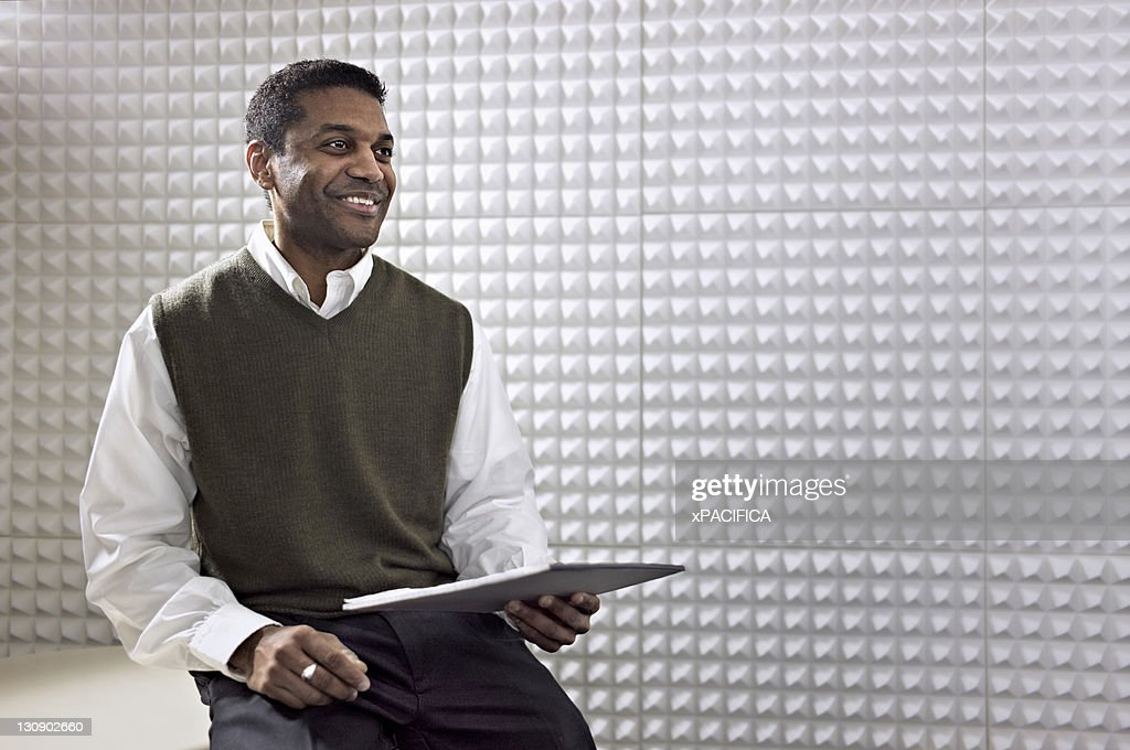 An office worker with a clipboard : Stock Photo