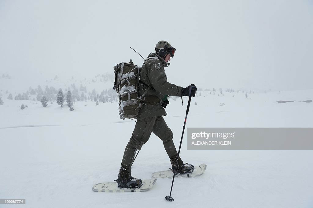 An officer from the Austrian armed forces from the 6th Infantry Brigade (6. Jaegerbrigade), of the 2nd Engineer Battalion Salzburg (Pionierbatallion 2), walks with snowshoes as he conducts an alpine training winter exercise (above 2000m altitude) during a foggy and snowy day in the Tuxer mountains near Wattens on January 16, 2013. Austrians will decide on Sunday whether to maintain compulsory military service or switch to a professional army in a referendum that has split the small, neutral country.