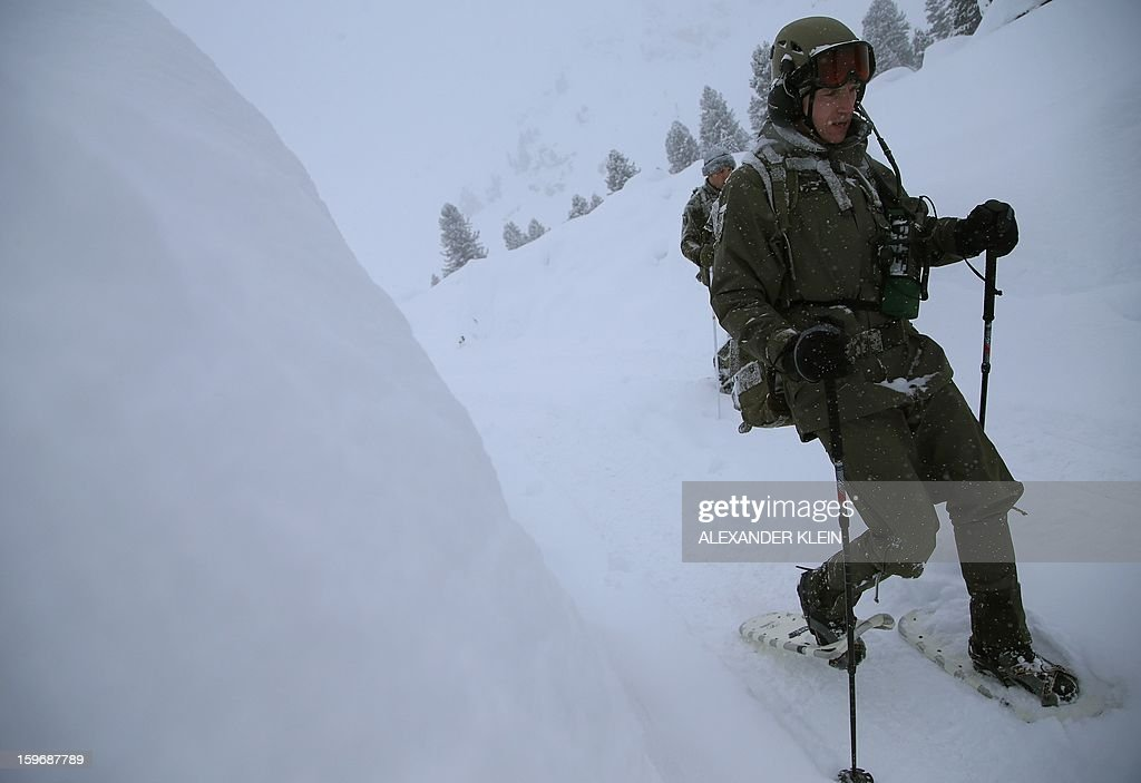 An officer from the Austrian armed forces from the 6th Infantry Brigade (6. Jaegerbrigade), of the 2nd Engineer Battalion Salzburg (Pionierbatallion 2), walk with snowshoes as he conducts an alpine training winter exercise (above 2000m altitude) during a foggy and snowy day in the Tuxer mountains near Wattens on January 16, 2013. Austrians will decide on Sunday whether to maintain compulsory military service or switch to a professional army in a referendum that has split the small, neutral country.