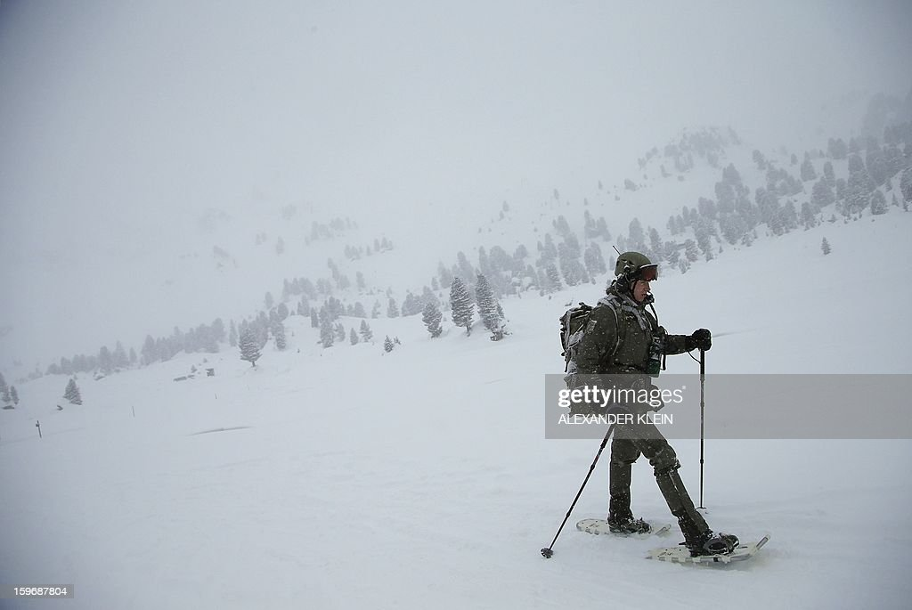 An officer from the Austrian armed forces from the 6th Infantry Brigade (6. Jaegerbrigade), of the 2nd Engineer Battalion Salzburg (Pionierbatallion 2), walks with snowshoes as he conducts an alpine training winter exercise (above 2000m altitude) during a foggy and snowy day in the Tuxer mountains near Wattens on January 16, 2013. Austrians will decide on Sunday whether to maintain compulsory military service or switch to a professional army in a referendum that has split the small, neutral country. AFP PHOTO / ALEXANDER KLEIN
