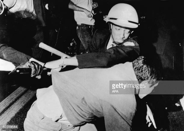 An officer from the Chicago Police Department struggles with an antiwar demonstrator outside Democratic headquarters at the Hilton Hotel on Michigan...