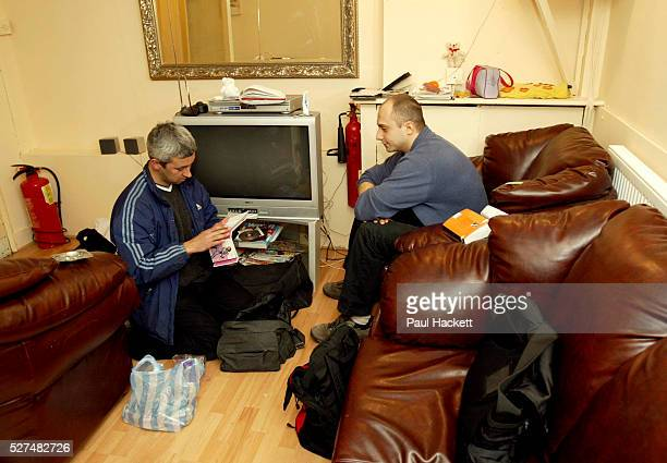 An officer from the clubs and vice unit look through material during a raid on the 'Ishka' sauna Hornsey North London Scene where a multi million...