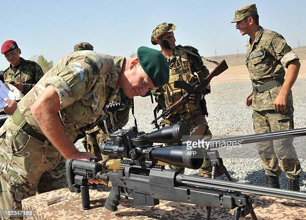 An officer looks at a machine gun during a military exercise at the Marshal Bagramian training grounds near the ArmeniaTurkey border in Armenia on...
