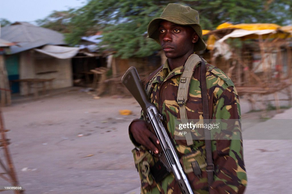 An officer of the General Service Unit (GSU) patrols the town of Garsen, in the Tana Delta Region, to impose the curfew that has been put in place as a security measure, on January 11 2013. Kenya's police chief said on January 11 that a spate of tribal clashes in the southeast of the country may be linked to politics and be part of a bid to drive out one community ahead of March 4 elections. This week 19 people were killed in the two separate raids in the volatile Tana River delta region, where scores have died since clashes broke out in August, and police are investigating local politicians for alleged involvement.