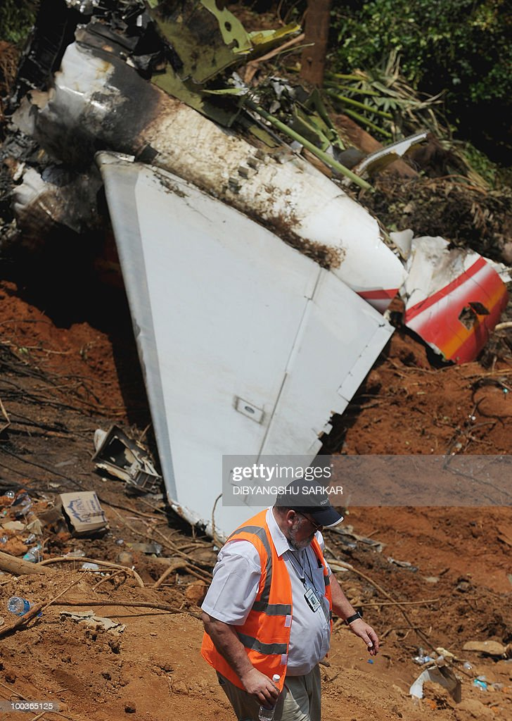 An officer of the Kenyon International Emergency Services inspects the Air India Express Boeing 737-800 in Mangalore on May 24, 2010. Investigators combed the wreckage of an Air India Express jet that crashed into a forested gorge with the loss of 158 lives, searching for the 'black box' data recorder. AFP PHOTO/Dibyangshu SARKAR
