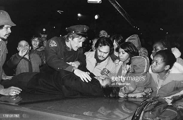 An officer of the NYPD 9th Precinct tends to an unconscious girl on the Lower East Side New York City 1978