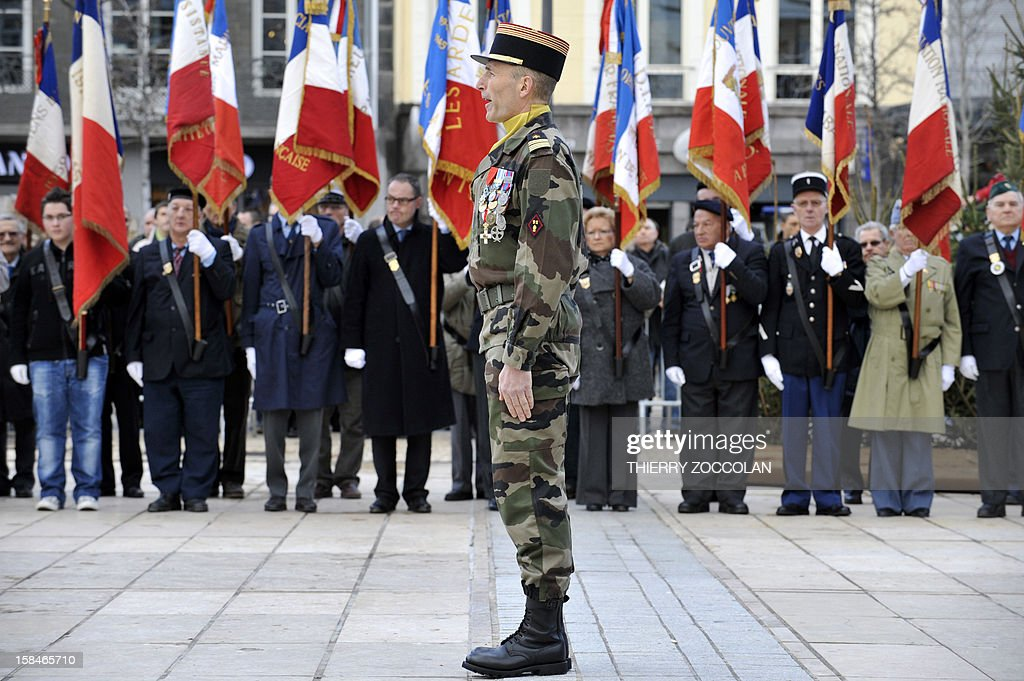 An officer reviews the troops, on December 17, 2012 in Clermont-Ferrand, central France, during a ceremony marking the dissolution of a joint tactical bataillon that served in Afghanistan from May to November 2012. France joined the NATO coalition in late 2001 to help prop up the new government against an insurgency, which began after a US-led invasion toppled the Taliban government earlier that year for giving refuge to Osama bin Laden and his Al-Qaeda network, following the 9/11 attacks on New York and Washington. ZOCCOLAN