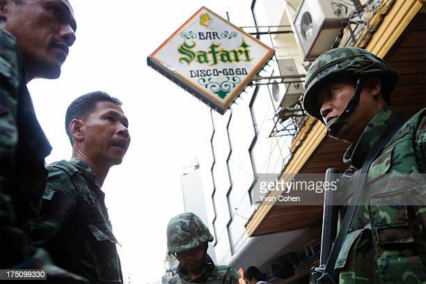 An officer speaks to one of his men posted in the red light district of Patpong off Silom Road Troops have taken up positions in the Silom area of...