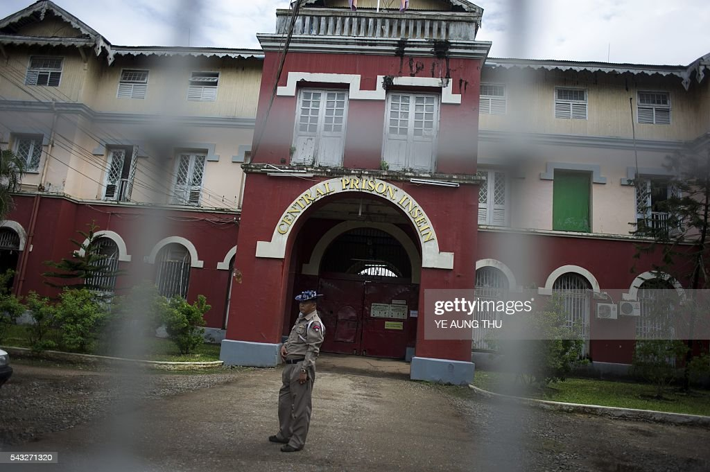 An officer stand guards before a visit by Yanghee Lee (not pictured), the United Nations Special Rapporteur on the situation of human rights in Myanmar, at Central Prison Insein in Yangon on June 27, 2016. Lee is on her fourth visit to Myanmar from June 19 to July 1. / AFP / YE
