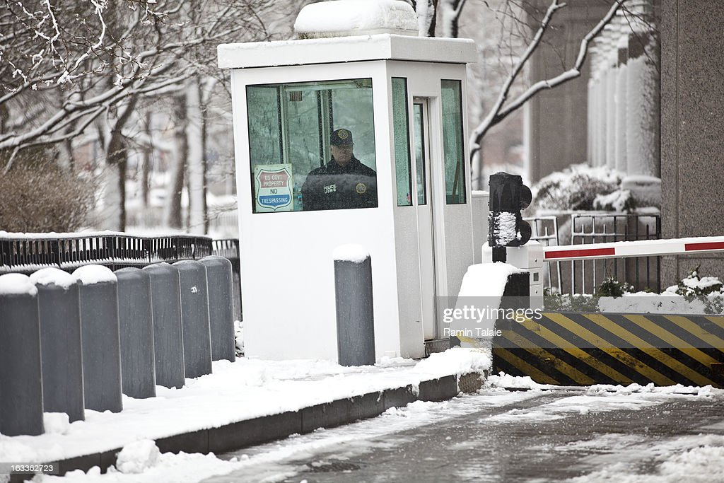 An officer stands guard inside a security booth at the Daniel Patrick Moynihan United States Court House where Sulaiman Abu Ghaith was arraigned on March 8, 2013 in New York City. Abu Ghaith, a son-in-law of Osama bin Laden and former associate, plead not guilty at his arraignment on charges of conspiracy to kill Americans.