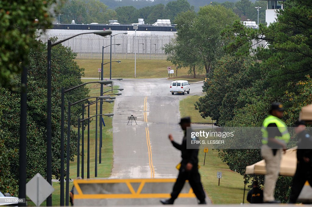 An officer with the Georgia Department of Corrections is seen at the entrance of the Georgia Diagnostic and Classification Prison in Jackson Georgia...