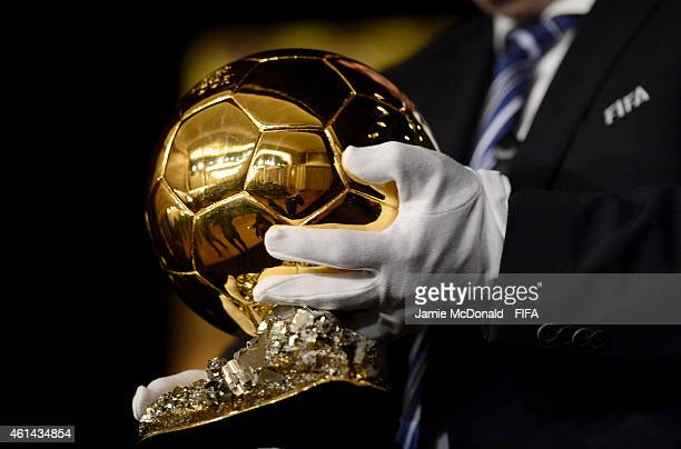 An official brings out the FIFA Ballon d'Or trophy before the nominees press conference for the FIFA Ballon d'Or 2014 prior to the FIFA Ballon d'Or...