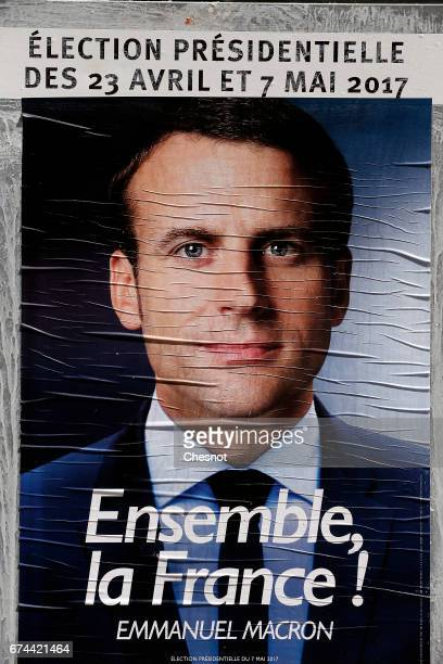 An official campaign poster of French presidential election candidate for the En Marche movement Emmanuel Macron is displayed on April 28 2017 in...