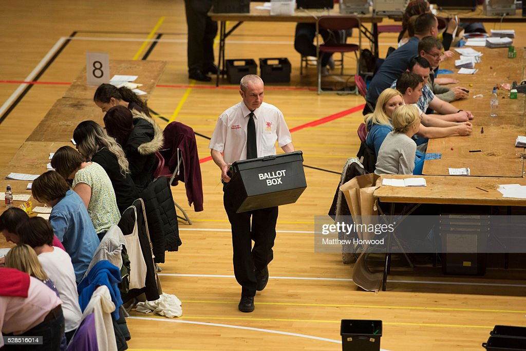 An official carries a ballot box during the National Assembly for Wales election count at the Sport Wales National Centre on May 05, 2016 in Cardiff, Wales. Today the UK went to the polls to vote for assembly members, councillors, mayors and police commissioners.