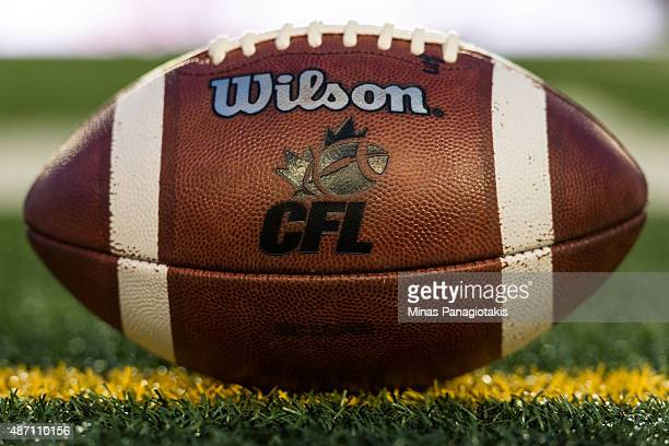 An official CFL football sits on the field during the CFL game between the Montreal Alouettes and the BC Lions at Percival Molson Stadium on...