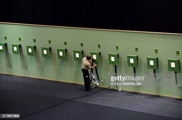 An official changes the controlband of targets in AUDI Arena of Gyor on February 26 2016 prior to the qualification round of 10m air rifle category...