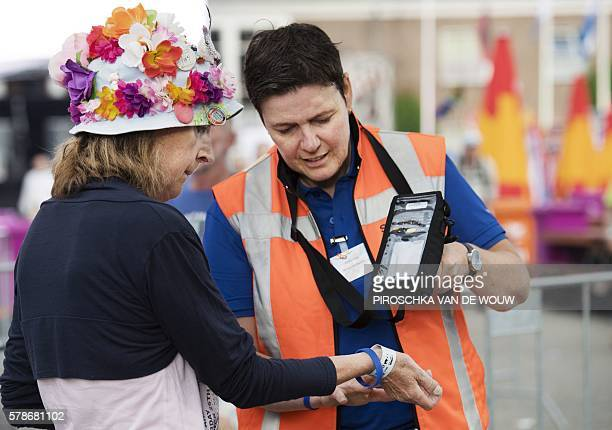 An official checks a participant at the start the fourth and final day of the 100th edition of the International Four Day Marches Nijmegen on July 22...
