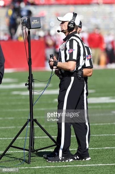 An official checks a replay during the game between the Maryland Terrapins and the Wisconsin Badgers at Camp Randall Stadium on October 21 2017 in...