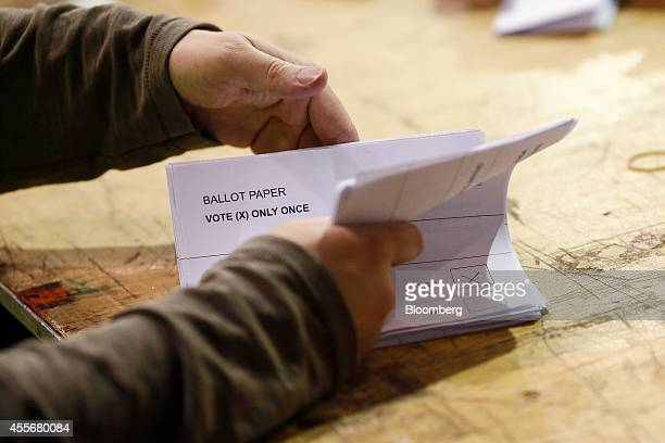 An official counts ballots papers for the Scottish independence referendum at the Royal Highland Center in Edinburgh UK on Thursday Sept 18 2014 The...