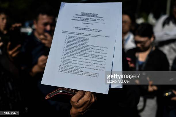 An official displays a document after a pretrial procedure for the the assassination of Kim JongNam the halfbrother of North Korean leader Kim JongUn...