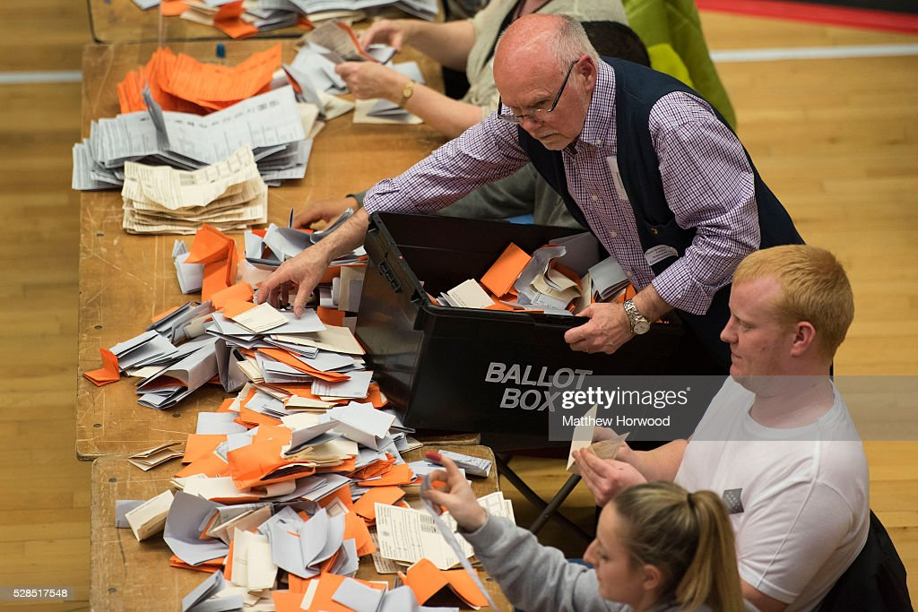 An official distributes ballot papers during the National Assembly for Wales election count at the Sport Wales National Centre on May 05, 2016 in Cardiff, Wales. Today the UK went to the polls to vote for assembly members, councillors, mayors and police commissioners.