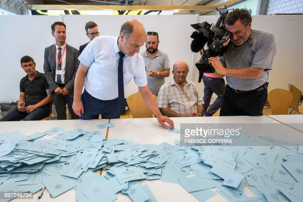 An official empties ballot boxes during the counting operation of an historical anticipated vote on June 18 2017 in Moutier northern Switzerland...