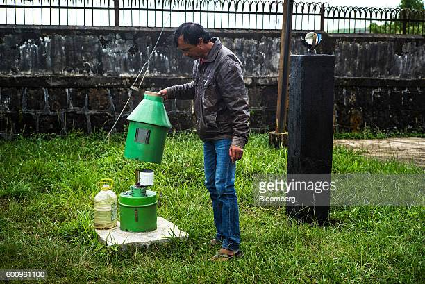 An official from India's meteorological department inspects a rain gauge in Cherrapunji Meghalaya India on Tuesday Aug 16 2016 Two years of deficient...