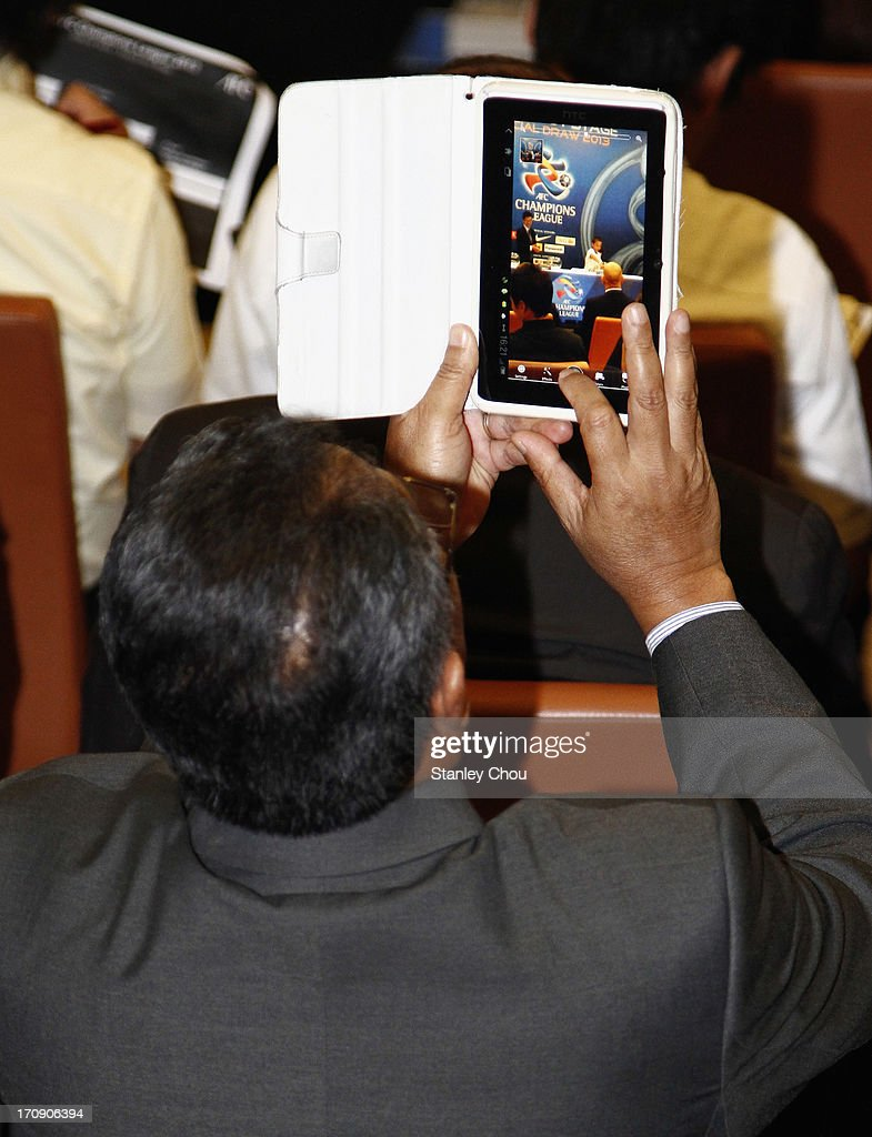 An Official from the audience takes pictures of the draw with an ipad during the 2013 AFC Champions League Quarter Finals Knock-out Stage Draw at the AFC House on June 20, 2013 in Kuala Lumpur, Malaysia.
