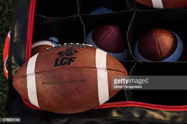 An official game day ball sits on top of the game ball bag during the CFL game between the Montreal Alouettes and the Ottawa Redblacks at Percival...