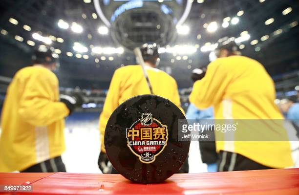 An official game puck for the China Games sits on the boards during the Los Angeles Kings practice at MercedesBenz Arena September 20 2017 in...