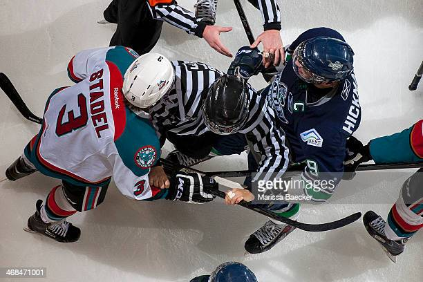 An official gets between Riley Stadel of the Kelowna Rockets and Justin Hickman of the Seattle Thunderbirds in the final moments of the third period...