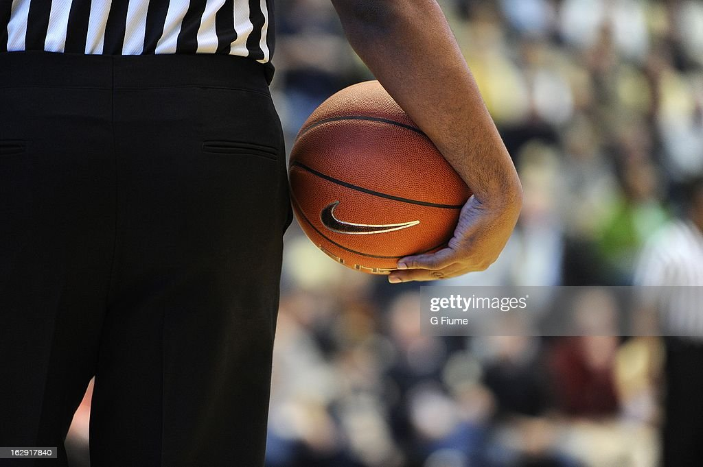 An official holds the basketball during the game between the George Washington Colonials and the Butler Bulldogs on February 9, 2013 at the Smith Center in Washington, D.C.