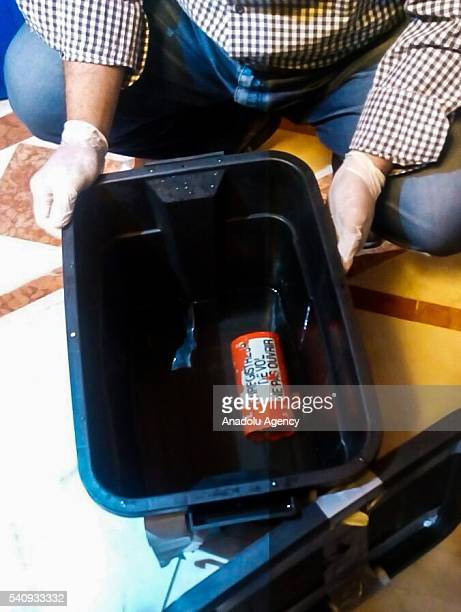 An official holds the flight recorder in Cairo Egypt on June 17 2016 EgyptAir flight MS804 crashed with 56 passengers and 10 crew on board on May 19