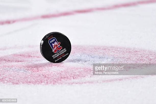 An official IIHF game puck sits on the faceoff dot during the IIHF World Junior Championship preliminary round game between Team Switzerland and Team...