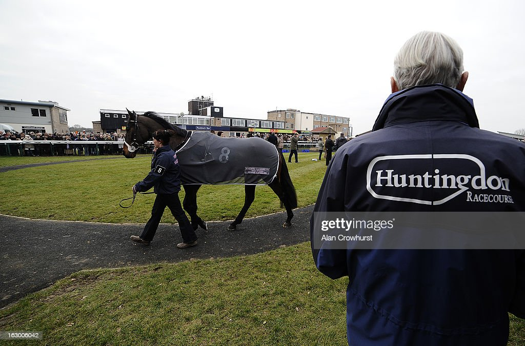 An official keeps an eye on the runners at Huntingdon racecourse on March 03, 2013 in Huntingdon, England.