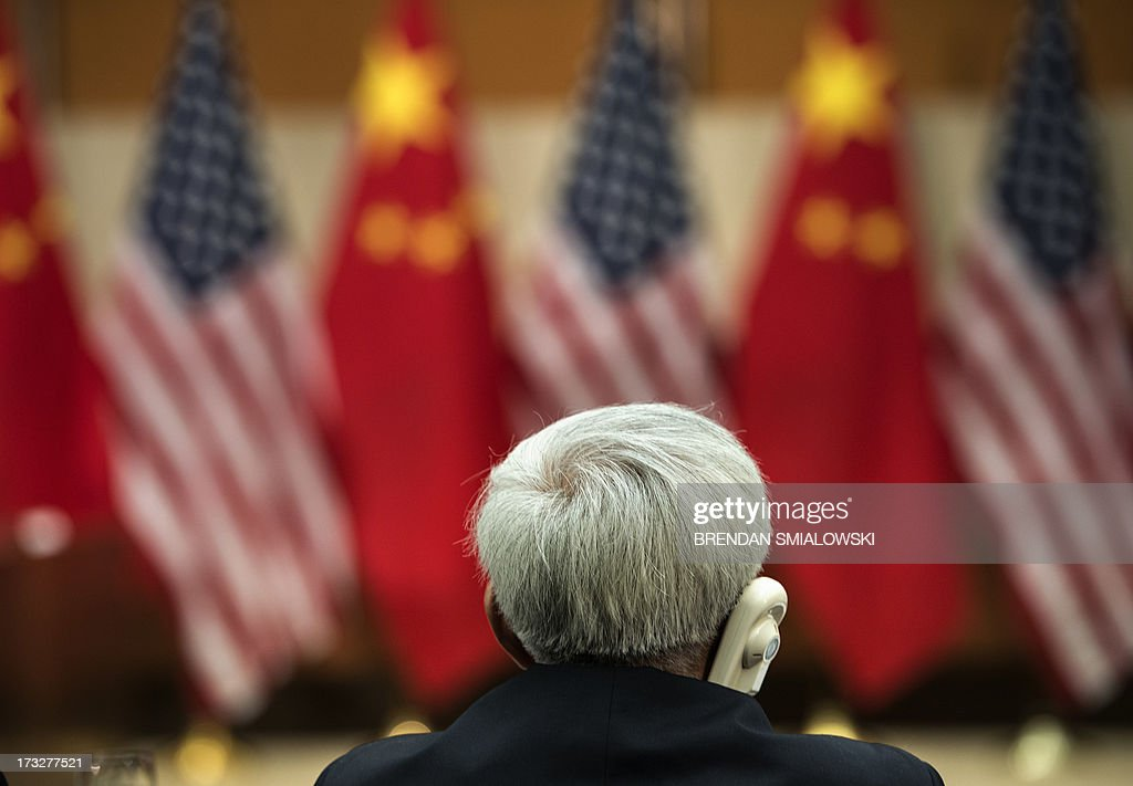 An official listens during a Strategic Track Plenary Session at the US Department of State July 11, 2013 in Washington, DC. Officials from the United States and China are meeting to discuss the two world powers' relationships. AFP PHOTO/Brendan SMIALOWSKI