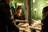 An official looks at documents as she officially registers people as Internally Displaced on October 10 2014 in Dnipropetrovsk Ukraine The United...