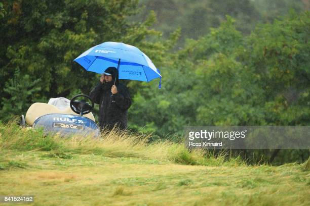 An official looks on as play is suspended during day two of the DD REAL Czech Masters at Albatross Golf Resort on September 1 2017 in Prague Czech...