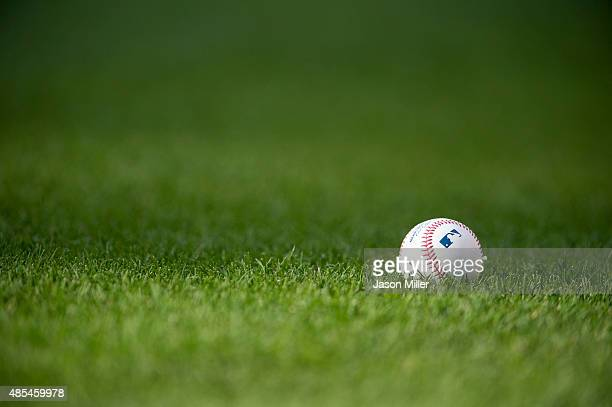 An official Major League Baseball sits on the infield grass at Progressive Field prior to the game between the Minnesota Twins and the Cleveland...