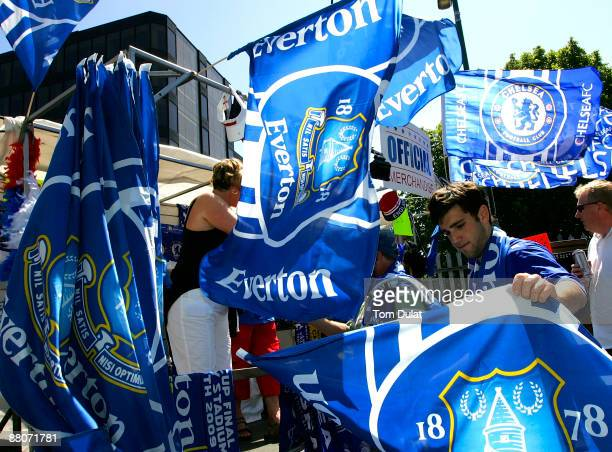 An Official merchandiser sells Everton flags prior to the FA Cup sponsored by EON Finalmatch between Chelsea and Everton at Wembley Stadium on May 30...