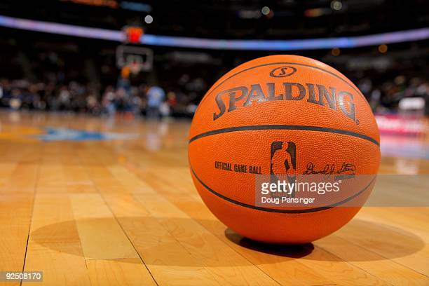 An official NBA game ball lies on the court ready for action prior to the game as the Denver Nuggets face the Utah Jazz during NBA action at Pepsi...