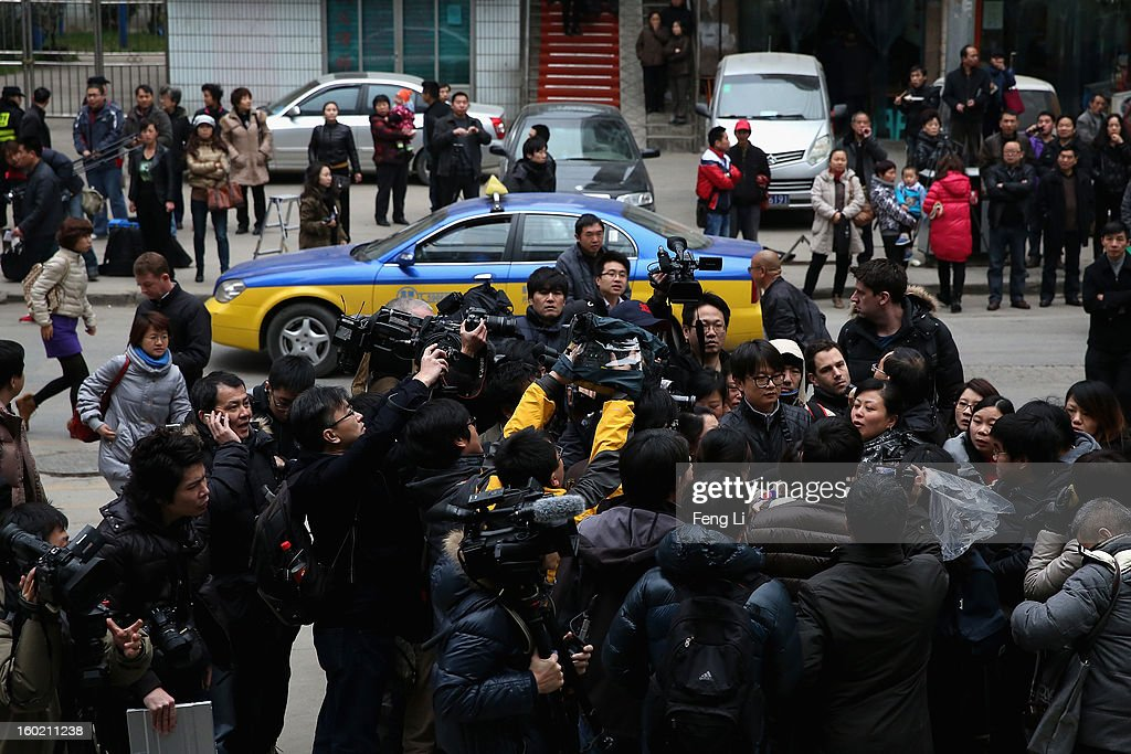 An official of Guiyang Intermediate People's Court leads the media to attend a press conference on former Chinese leader Bo Xilai's case on January 28, 2013 in Guiyang, China. 'It is fake information. The trial of Bo Xilai will not open in Guiyang today', Vice-president of Guiyang Intermediate People's Court Jiang Hao said. The trial of Bo Xilai is expected to open after the 'two sessions' in March, China's official newspaper Global Times reports on Monday.