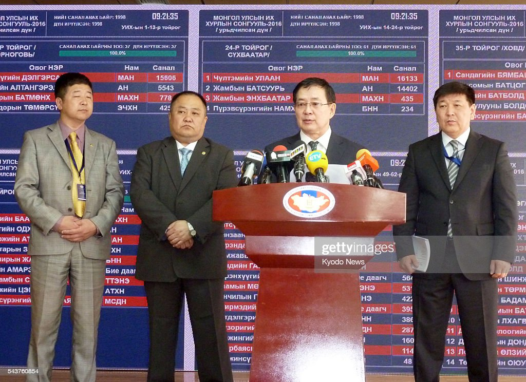 An official of Mongolia's national election commission announces the interim results of the country's parliamentary election in Ulan Bator on June 30, 2016. The main opposition Mongolian People's Party won 65 of the 76 seats in the unicameral legislature.