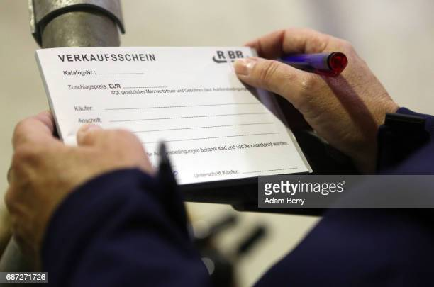 An official prepares a proof of purchase certificate during an annual heifer auction on April 11 2017 in Gross Kreutz Germany Around 80 Angus...
