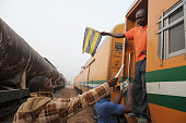 An official raises warning flag to passengers onboard LagosKano route train on February 8 2013 The rejuvenated Nigerian Railway Corporation has...