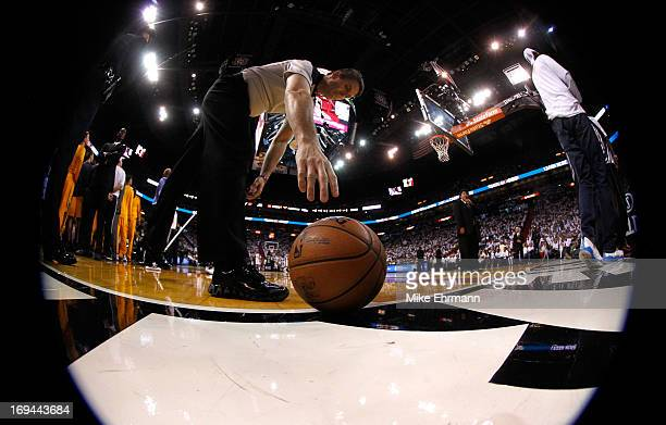 An official reaches to pick up the ball during Game Two of the Eastern Conference Finals between the Indiana Pacers and the Miami Heat at...