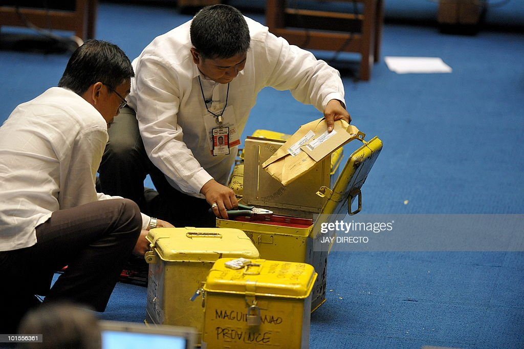 An official removes a certificate from a metal box during the resumption of national canvassing for the May 10 presidential elections at the House of Representatives in Quezon City suburban Manila on June 2, 2010. Benigno Aquino could be officially declared winner of the Philippine presidential election on June 15, senior legislators said, despite ongoing inquiries into alleged vote cheating. An unofficial count of over 90 percent of the votes has given the 50-year-old Aquino an insurmountable lead and almost all of his major rivals have conceded to him, but by law only the parliament can declare the winner.